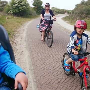 Riding through the dunes on park of the The North Sea Cycle Route