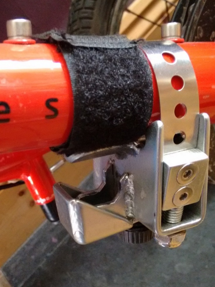 The down tube bracket separated from the velcro strap