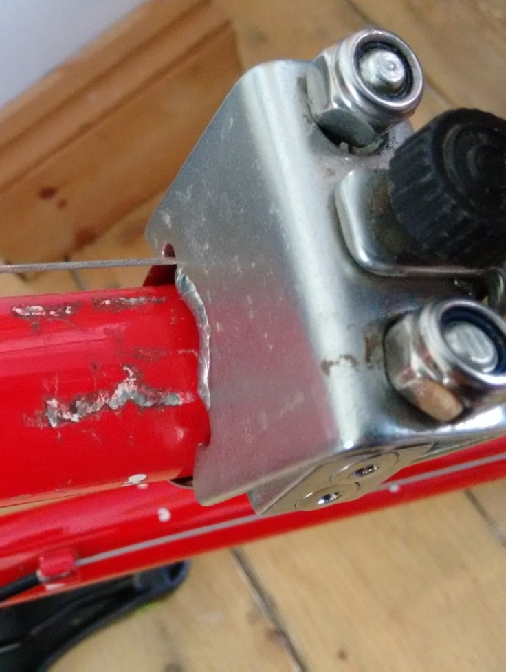 Damage to the down tube from where the down tube bracket has become loose