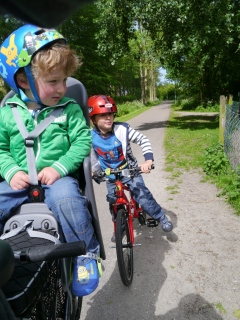 The boys on the bikes, looking at the animals