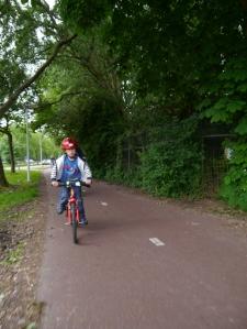Our eldest riding along the path