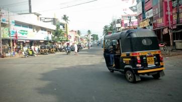 Auto rickshaw going round a corner