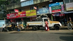 Auto rickshaws and a truck