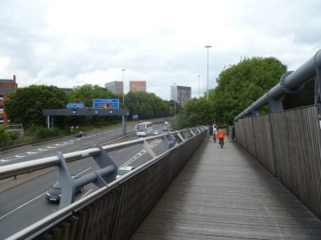Riding on the Horseshoe Bridge over the Mancunian Way