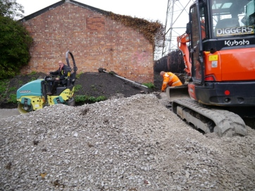 Workmen working on the new path
