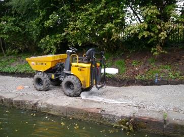 A mini dumper on the path under construction