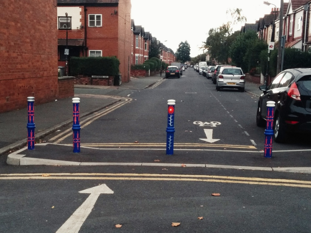 Bike themed bollards on filtered permeability
