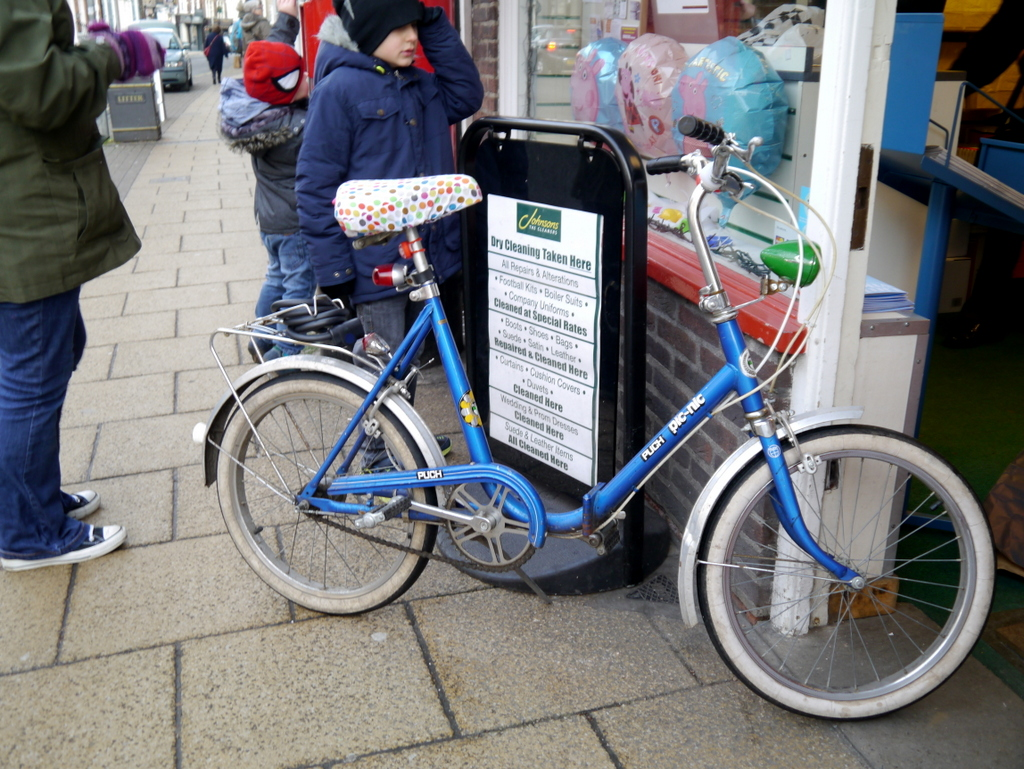 Puch shopper outside a post office