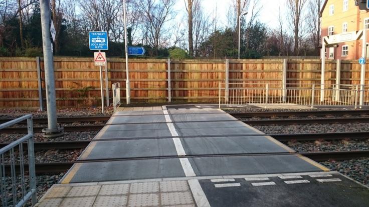 Crossing the Metrolink track at Didsbury Village