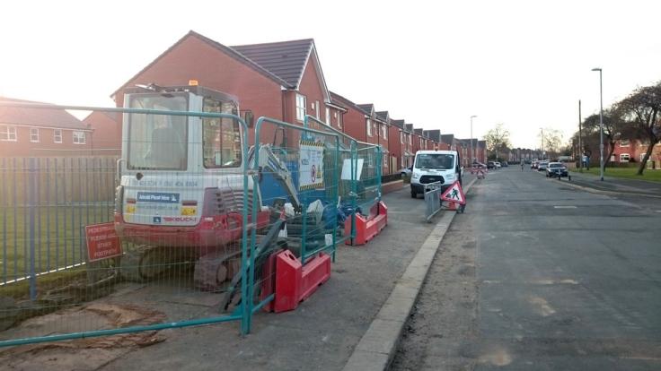 Construction vehicles blocking the pavement