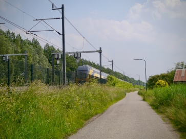 Double decker train passing us