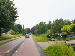 Fietstraat(cycle street), with bridges going to houses to the right