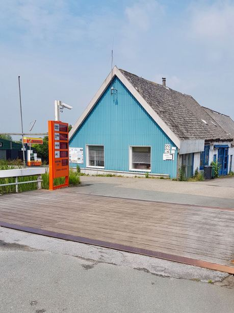 A very quaint old petrol station over a wooden bridge